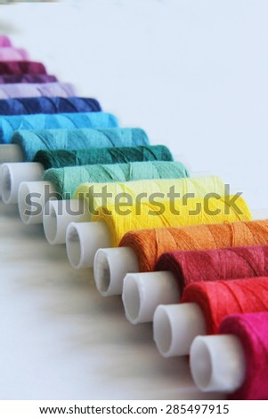 Sewing colored threads - stock photo