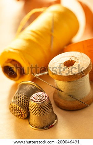 Sewing items, meter and thimble - stock photo