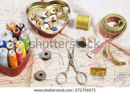 Sewing items on a sewing pattern - stock photo