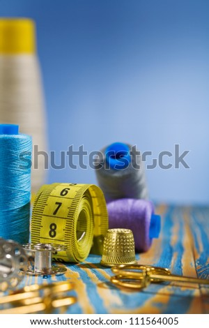 sewing items on blue background