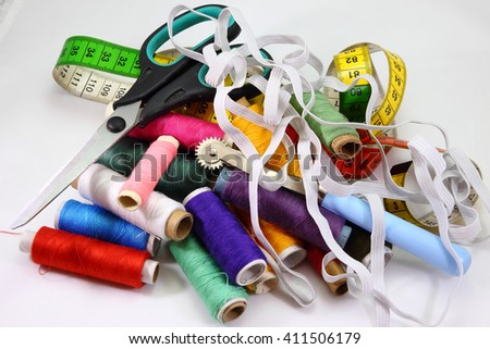 Sewing kit, ends in a variety of colors, needles, scissors, eraser, textiles. local focus