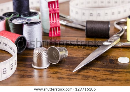 Sewing kit on wood table.