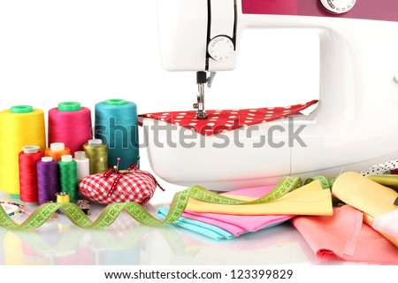 sewing machine and fabric isolated on white - stock photo