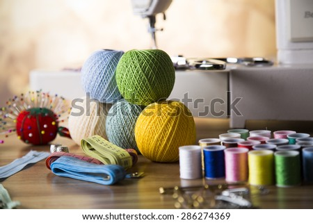sewing machine and fabric, threads, needles, pins