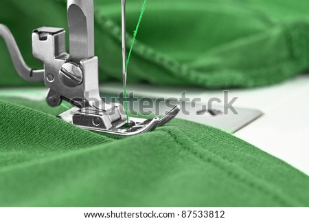 Sewing machine and item of clothing, detail - stock photo