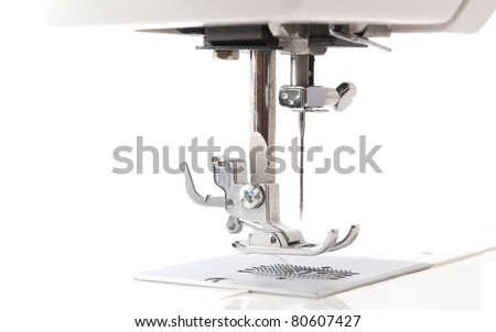 sewing machine monochrome on a white background - stock photo
