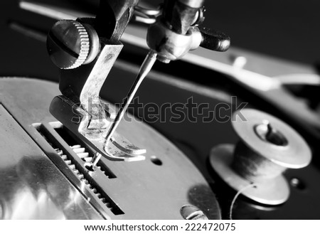 Sewing machine needle close up. - stock photo