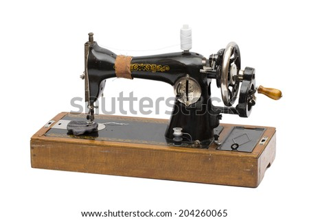 sewing-machine on the white background - stock photo