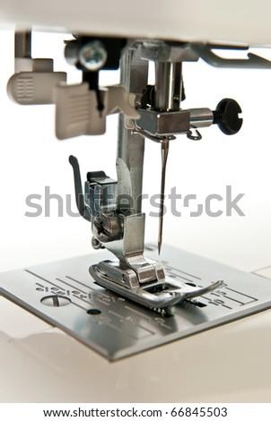 Sewing machine on white background - stock photo