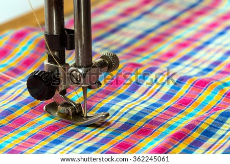 sewing machine - sewing process in the phase of sewing  - stock photo