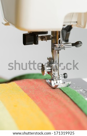 sewing machine working part with cloth