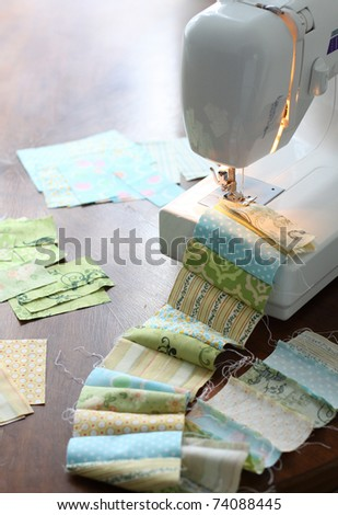 Sewing, making a quilt - stock photo