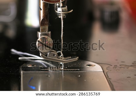 Sewing of working with fabric. - stock photo