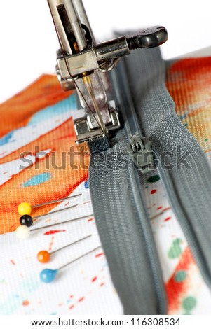 Sewing on a zipper with a sewing machine with colorful material