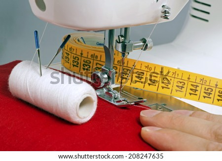 sewing process in the phase of overstitching - stock photo