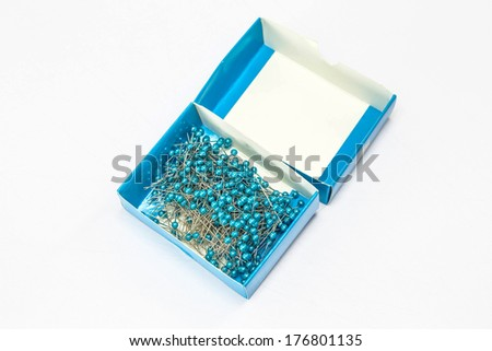 sewing push pin in the box on a white background - stock photo