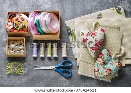 Sewing set: fabrics and threads - stock photo