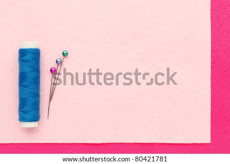 Sewing Supplies on clothing - stock photo