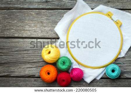 Sewing Supplies on Wood Background