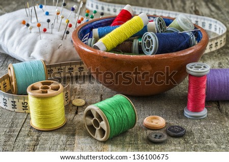 Sewing supplies with great light and colors - stock photo