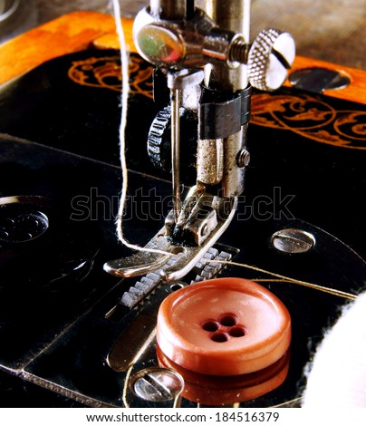 Sewing. The sewing machine and accessories (threads, needle, buttons). - stock photo