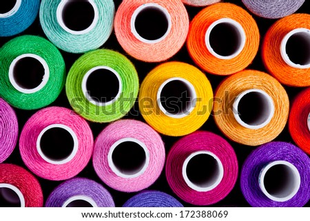Sewing threads as a multicolored background close up