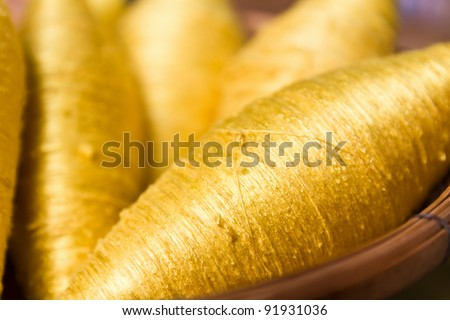 Sewing threads golden color  closeup - stock photo