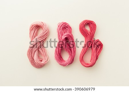 Sewing threads in pink tone. - stock photo