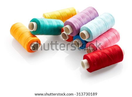 Sewing threads isolated on white background - stock photo