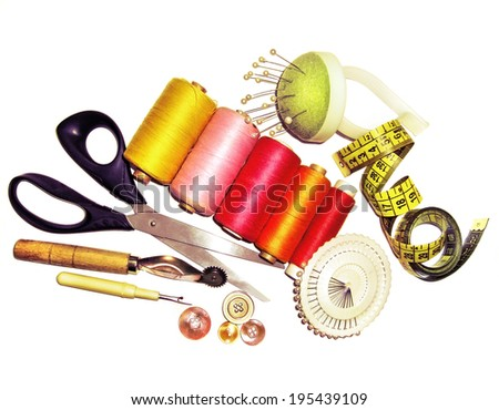 Sewing tools and accessories on a white background - stock photo