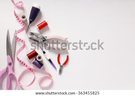 Sewing tools on the table - stock photo