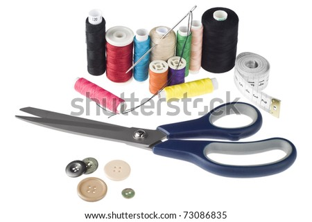Sewing tools on white background (scissors, needle, spools, buttons) - stock photo
