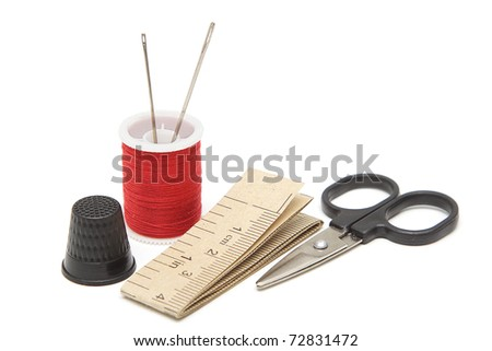 Sewing tools: spool of thread, needles, scissors, measuring tape, thimble isolated on white background