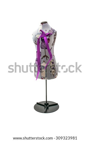 Sewing variegated mannequin with lilac bow  isolated on white background - stock photo