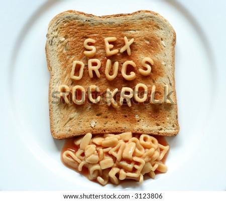 sex drugs rock roll written with alphabetti spaghetti pasta shapes on toast - stock photo