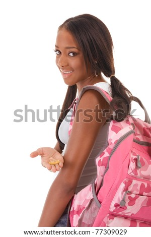 Sex education Friendly ethnic black woman high school student with backpack and condom - stock photo