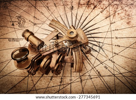 Sextant on an old map - stock photo
