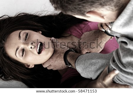 Sexual abue concept. Brutal man rapeing young woman - stock photo