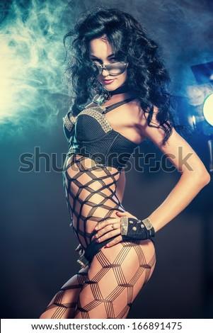 Sexual brunette girl dancing at nightclub. - stock photo