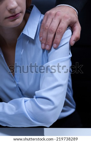 Sexual bullying by boss at workplace - stock photo
