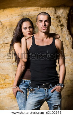 Sexual couple near the rock - stock photo