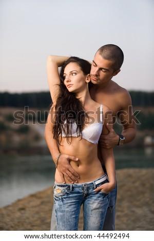 Sexual couple on a beach - stock photo
