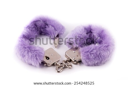 Sexual cuffs with purple fur on a white background - stock photo