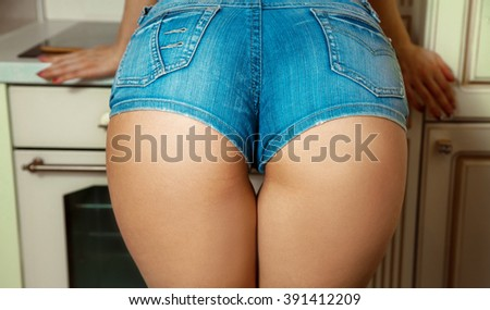 Sexual female ass in jeans shorts. Sexual female ass. Woman buttocks. Female back. - stock photo