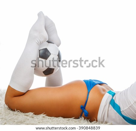 Sexual female posing with soccer ball. - stock photo