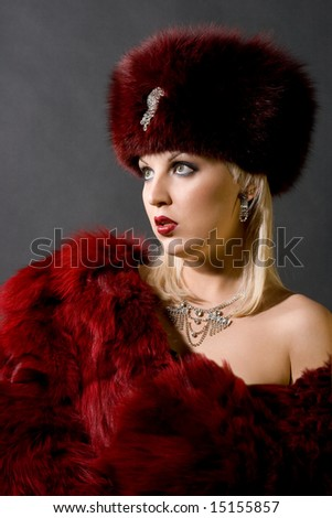 sexual girl in a red fur cap