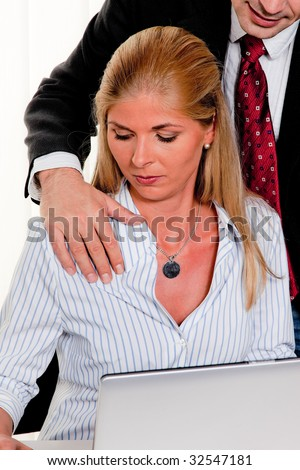 Sexual harassment of a woman at work in the office - stock photo