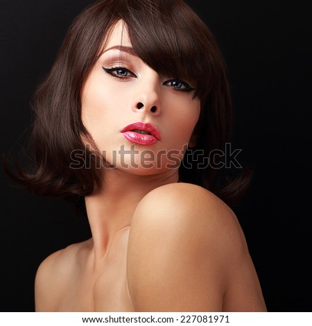 Sexual makeup woman with red sexy lips and short brown hair looking. Closeup portrait on black background - stock photo
