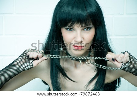 Sexual sadomaso girl with a chain, slightly toned image - stock photo