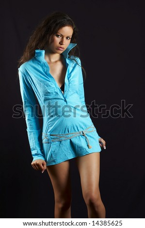 sexual  young girl in turquoise gown - stock photo